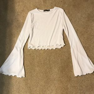 White lettuce edge crop top with bell sleeves